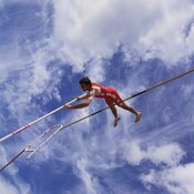A pole vaulter's shoulder strength helps him to push off the pole.