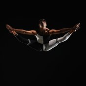 Straight knees and pointed feet make straddle jumps impressive.