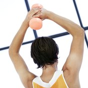Overhead weightlifting develops the triceps brachii.