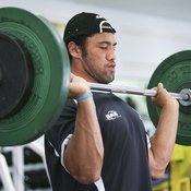 Weight-training increases muscle and bone mass, altering your body composition.