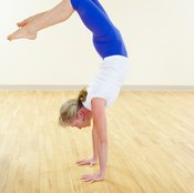 The handstand requires power, controlled strength and neuro-muscular coordination.