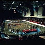 A standard indoor track measures 200 meters, making the mile race eight laps plus nine meters.