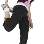 A woman performs a safe quad stretch.