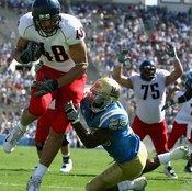 Tight end Rob Gronkowski scores a touchdown for the University of Arizona in 2008.