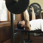 The bench press exercise works the chest, triceps and shoulders.