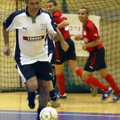 Jose Mourinho, coach of the London team Chelsea, joins an indoor game for a change of pace.