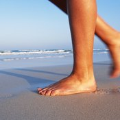 Walking barefoot can build strength in the muscles that support your arch.