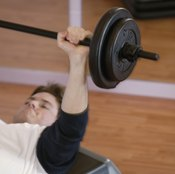 The bench press is completed lying on your back on a flat surface.
