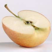 Applesauce contains slightly less fiber, per serving, compared to a whole apple.
