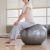 Bouncing on the balance ball may warm your core before exercise.