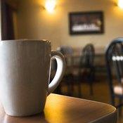 A white coffee mug on a cafe counter.