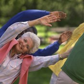 A combination of aerobics and strength training helps develop slim, toned arms.