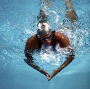 The breaststroke requires you to bend then extend your elbows, working your triceps.