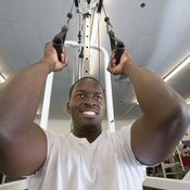 Gym pulley machines can be used for both arms and legs, but the ankle strap is typically used for leg exercises.