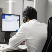 Sitting hunched over your desk can lead to pain under the shoulder blades.
