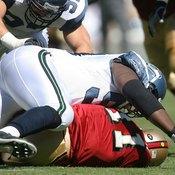 Shoulder pads partially absorbed Seahawks' lineman Rocky Bernard's 308-pound body slam to 49ers' quarterback Alex Smith.