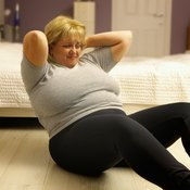 Situps can strengthen your abdominals, but won't reduce fat.