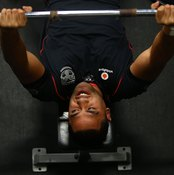 Perform different types of bench press to work your chest and shoulders.