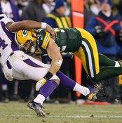 Packers outside linebacker Clay Matthews tackles the Vikings' Joe Webb.