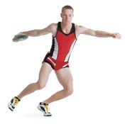 Discus throwers must perfect their balance while spinning.