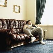 Overweight man on sofa