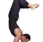Muscular strength can help some men to achieve yoga feats of strength and agility.
