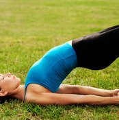 Practice yoga poses to reverse kyphosis.