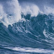 Tsunamis are huge waves generated by underwater earthquakes or volcanic eruptions.