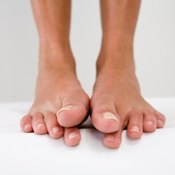 Stretch hammer toes before and after taping to further increase flexibility and relieve discomfort.