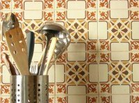 Ready to change out your backsplash? Learn how to remove tile from a kitchen wall.