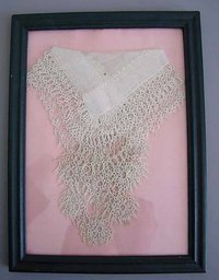 Framed vintage hankies make wonderful decorations