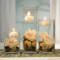 Candles, stone and vases help in creating beautiful outdoor wedding table decorations