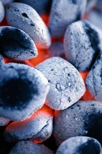 Charcoal is activated with flame so that it's effective for cooking food on a charcoal grill.