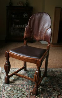 Repair leather and wood furniture with contact cement.