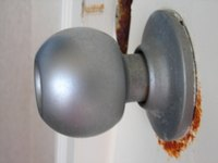Most doorknobs can be removed with a screwdriver.