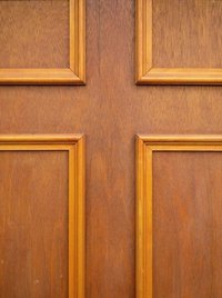 A plain panel door dressed up with decorative molding.