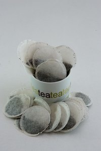 Tea bags are used to stain paper and poster boards.