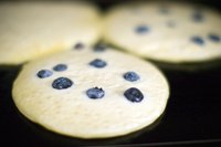 The large, flat surface of a griddle allows you to cook many pancakes at once.