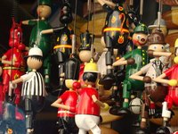 Marionettes are puppets manipulated by strings.