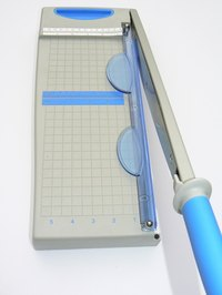 A paper cutter will save you much time and frustration as you can cut accuratly and multiple sheets at once.