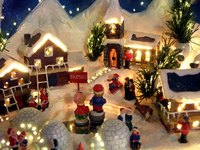 A lighted Christmas village display