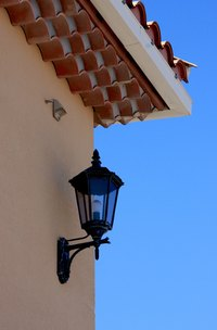 Exterior light fixtures add style and character to a stucco wall.