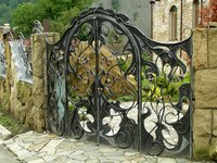 A beautifully ornate wrought iron garden gate