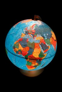 Creating a globe with cut-out continents can make learning fun for kids.