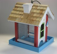 Pine wood shingles add to the look of a plain bird house.