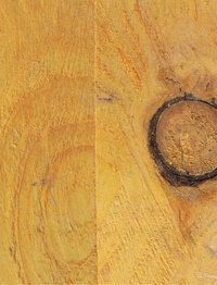 Removing linseed oil from wood can be done by using turpentine.