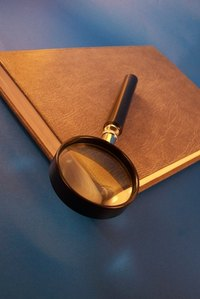 Every good pretend detective needs a clue notebook and a magnifying glass.