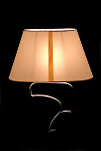 Make an ordinary lamp shade rotate.
