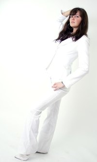 Wear a white blazer and white pants for a chic white party look.
