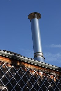 Metal chimneys go through roofs to ventilate heat and smoke from a home.